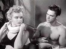 Marilyn et Keith Andes dans Le démon s'éveille la nuit (1952)